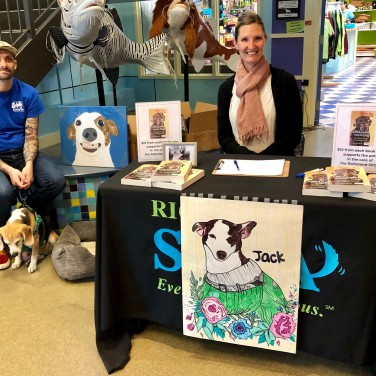 Matty, Sadie, and I surrounded by paintings and drawings of Jack at our signing table.